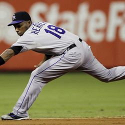 Colorado Rockies shortstop Jonathan Herrera stretches out to field a ground-out by Philadelphia Phillies' Chase Utley in the third inning of the second game of a baseball doubleheader, Sunday, Sept. 9, 2012, in Philadelphia.