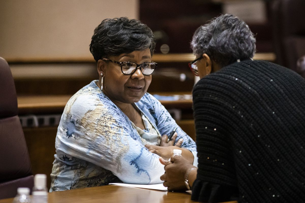 Ald. Michelle Harris (8th) chats with another alderman during a Chicago City Council meeting last month.