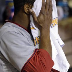 Washington Nationals starting pitcher Edwin Jackson wipes off with a towel as he sits in the dugout after being pulled out of a baseball game during the second against the St. Louis Cardinals on Friday, Sept. 28, 2012, in St. Louis.
