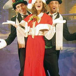 """Phillip Lowe, left, Kirsten Nagel and Justin Berry in the Desert Star Dinner Theater's Christmas musical revue, """"Home for the Holidays."""""""