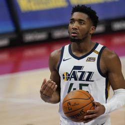 Utah Jazz guard Donovan Mitchell prepares to shoot a free throw during the first half of an NBA basketball game against the Detroit Pistons, Sunday, Jan. 10, 2021, in Detroit.