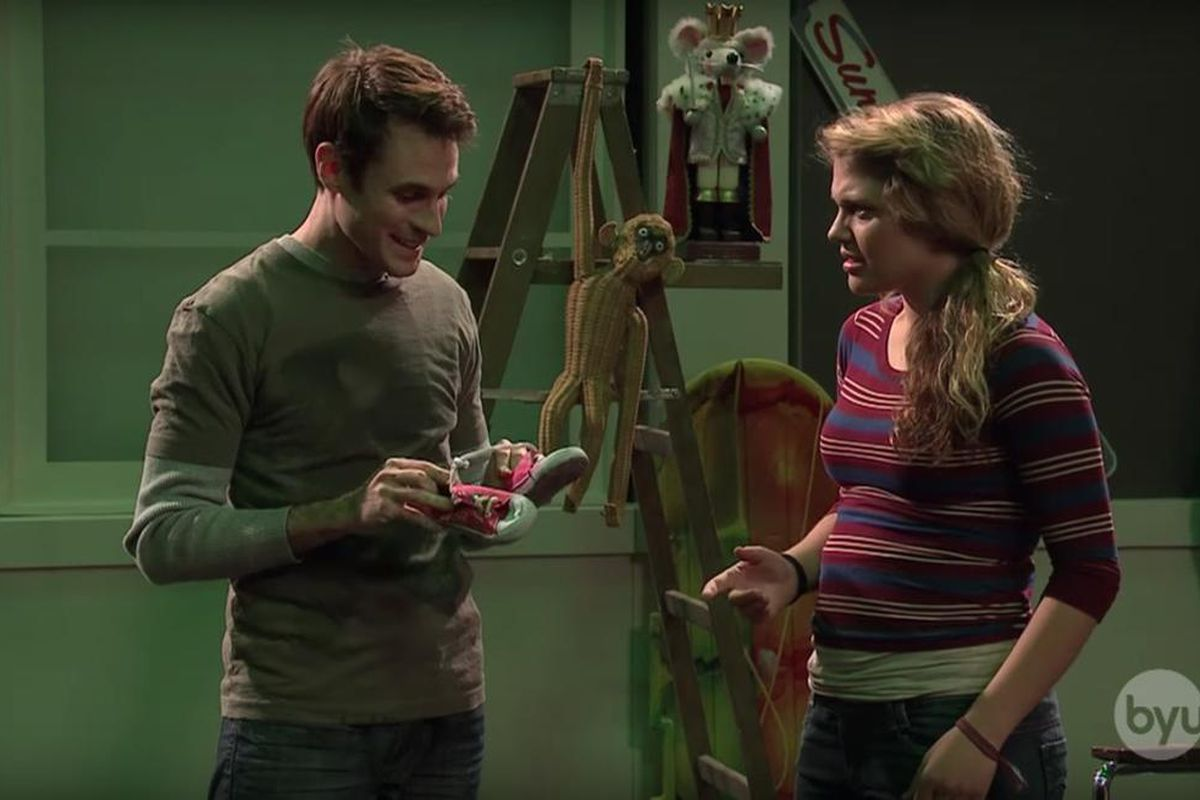 Matt Messe explains to Mallory Everton his New Year's resolution to steal things in a 2012 Studio C comedy sketch.