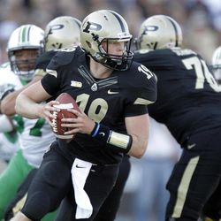 Purdue quarterback Caleb TerBush drops back to throw against Marshall during the second half of an NCAA college football game in West Lafayette, Ind., Saturday, Sept. 29, 2012. Purdue defeated Marshall 51-41.