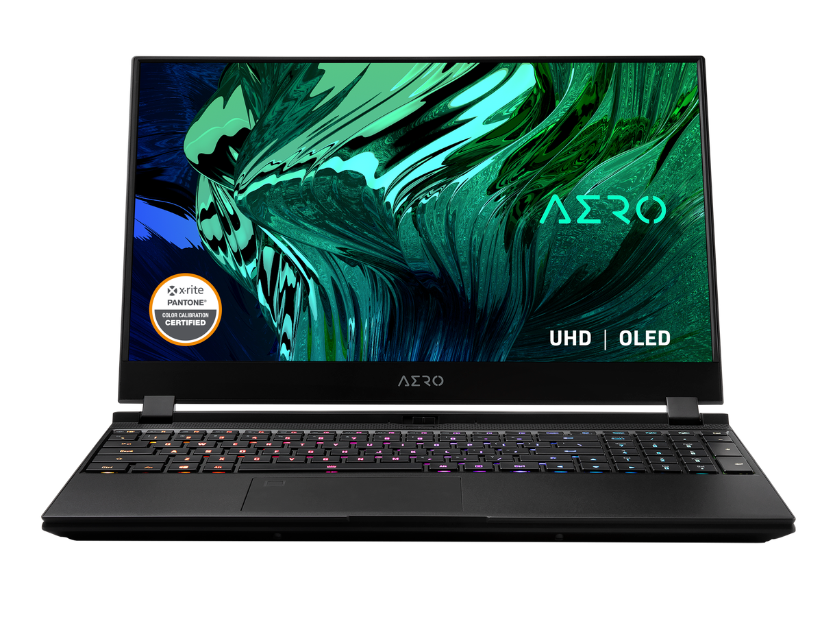 The Gigabyte Aero 15 OLED open against a white background with RGB keyboard illuminated. The screen displays the Aero logo on a green mosaic background.