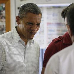 President Barack Obama makes a face as he greets young children and their parents during his unannounced stop to West Tampa Sandwich Shop and Restaurant, Saturday, Sept. 8, 2012, in Tampa, Fla.