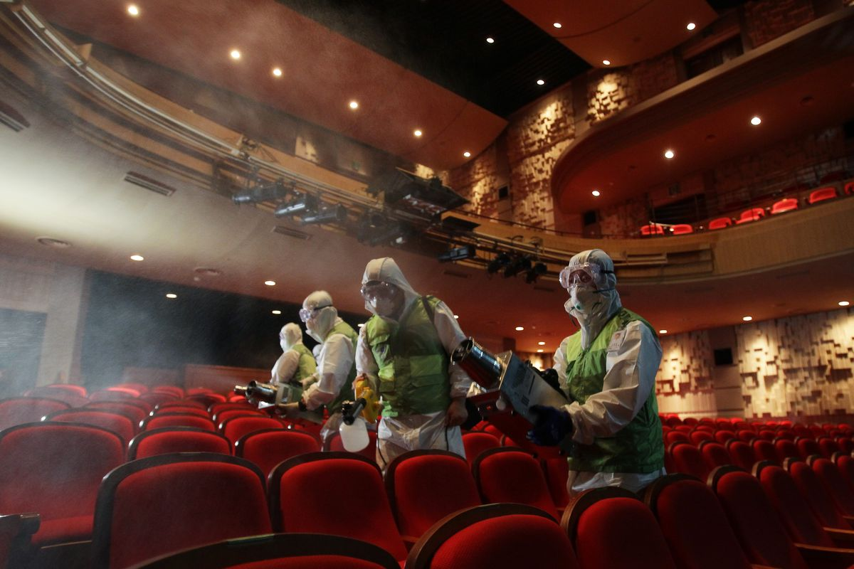 Disinfection workers wearing protective gears spray antiseptic solution in Sejong Cultural Center amid rising public concerns over the spread of MERS in Seoul, South Korea.