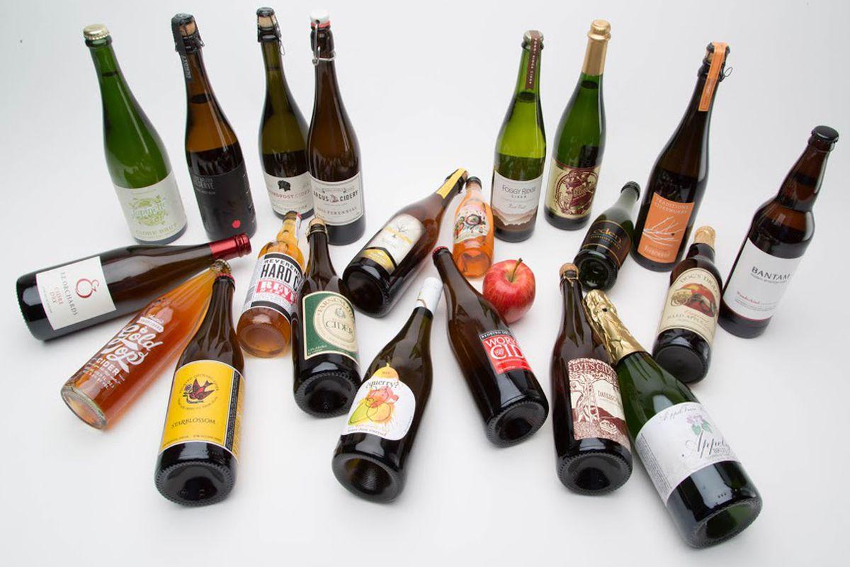 Assorted cider bottles.