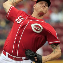 Cincinnati Reds starting pitcher Mat Latos throws against the Milwaukee Brewers in the first inning of a baseball game, Thursday, Sept. 27, 2012, in Cincinnati.