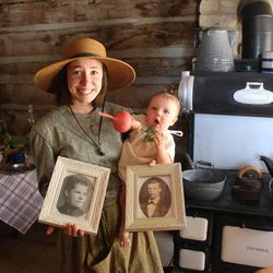 John Rowe Moyle's descendant Hannah Emery holds her baby cousin and photos of Thomas Barratt Whitby and Emma Sarah Freestone Whitby, another pioneer couple who came west with a handcart company in July 2014. Visitors can come to Moyle Park and listen to stories of the pioneers who settled in Utah.