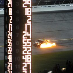 Ryan Newman's car catches fire during the NASCAR Sprint Cup Series auto race at Atlanta Motor Speedway, Sunday, Sept. 2, 2012, in Hampton, Ga.
