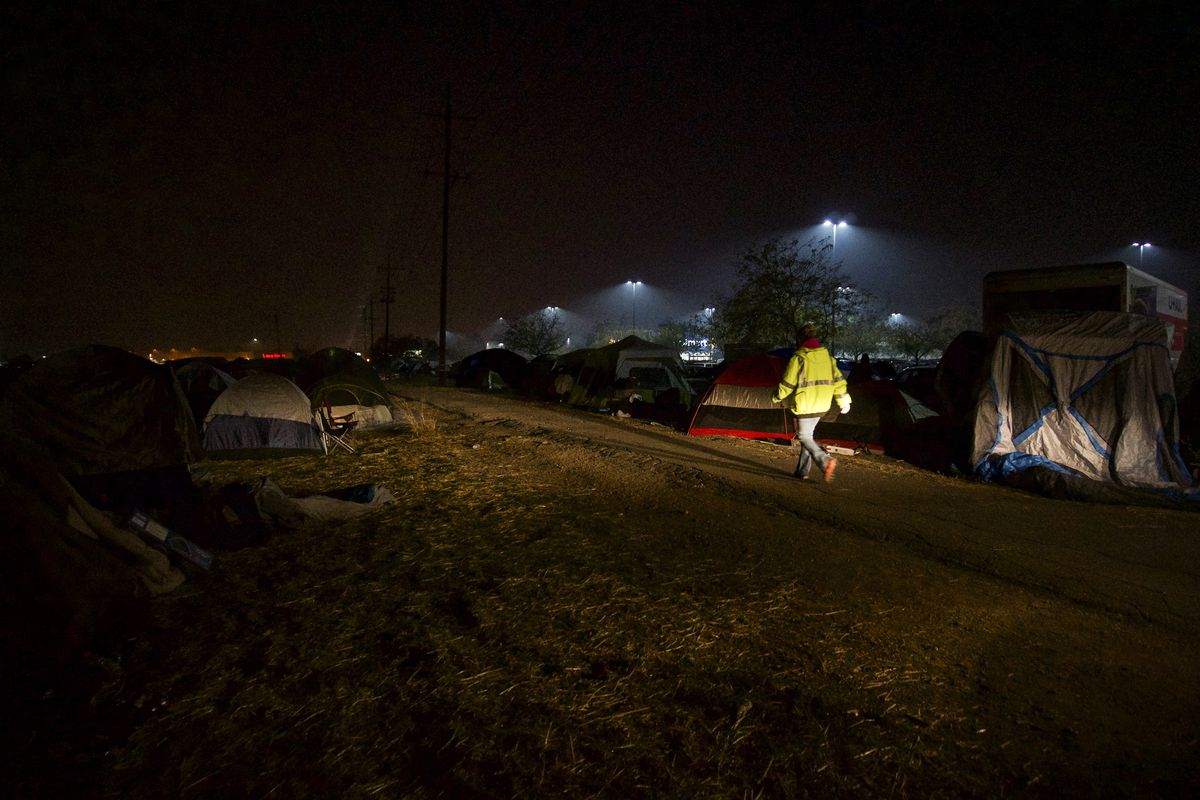 Evacuees from the Camp Fire pitched tents outside a Walmart in Chico, California.
