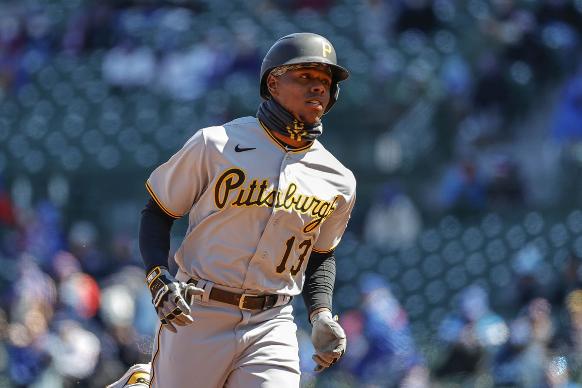 Pittsburgh Pirates third baseman Ke'Bryan Hayes (13) rounds the bases after hitting a two-run home run against the Chicago Cubs in the first inning at Wrigley Field.