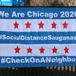 A sign displayed outside a home on the 5000 block of North Forest Glen Avenue on the Northwest Side, Tuesday, April 7, 2020.