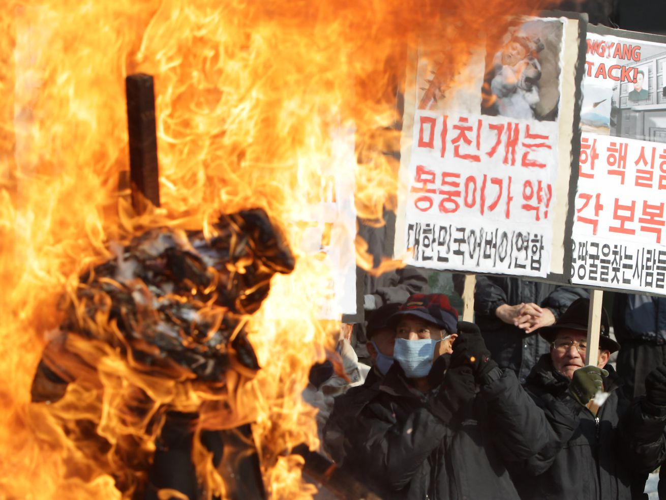 South Korean conservative protesters participate in a rally a day after North Korea announced it had conducted a third nuclear test on February 13, 2013, in Seoul.