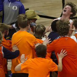 Brighton's Jace Matheson screams with excitement as he is mobbed by his fellow students after the Bengals stormed back against Orem and defeated them in overtime in a second round boys 5A state basketball tournament game at Brighton High School in Cottonwood Heights on Friday, Feb. 26, 2021.