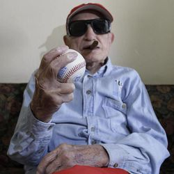 Cuban former pitcher Conrado Marrero, who once played with the Washington Senators, holds a ball as he poses for pictures during an interview in Havana, Cuba, Wednesday, April 25, 2012. Marrero, who last year became the oldest living former big leaguer, turned 101 on Wednesday.