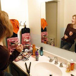 Alyssa Abbott tickles her daughter Morgan as Morgan gets ready for school in Spanish Fork, Wednesday, May 18, 2011.