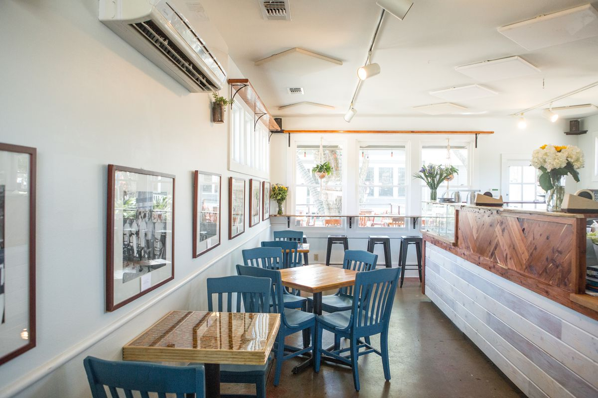 The back seating area of Mum Foods Deli showcasing the sun-drenched counter.