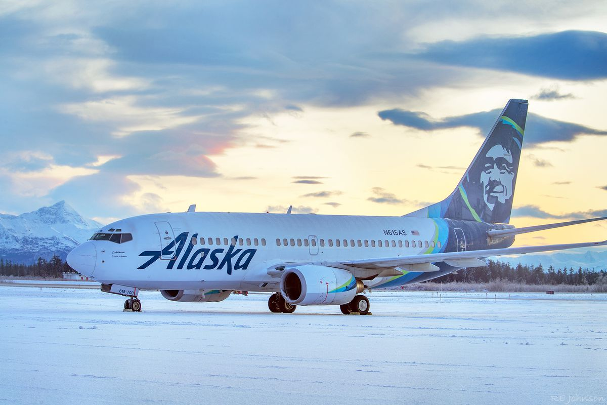 This early Sunday, Nov. 15, 2020, photo provided by R E Johnson shows an Alaska Airlines jet at Yakutat Airport in Yakutat, Alaska.