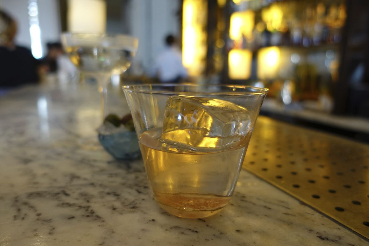 A picture of The Fig Reviver cocktail, at the Artesian bar at The Langham hotel in London, Wednesday, June 19, 2019. The martini's heyday began almost a century ago, but today's bartenders have some innovative takes on the classic cocktail. (AP Photo/Sian
