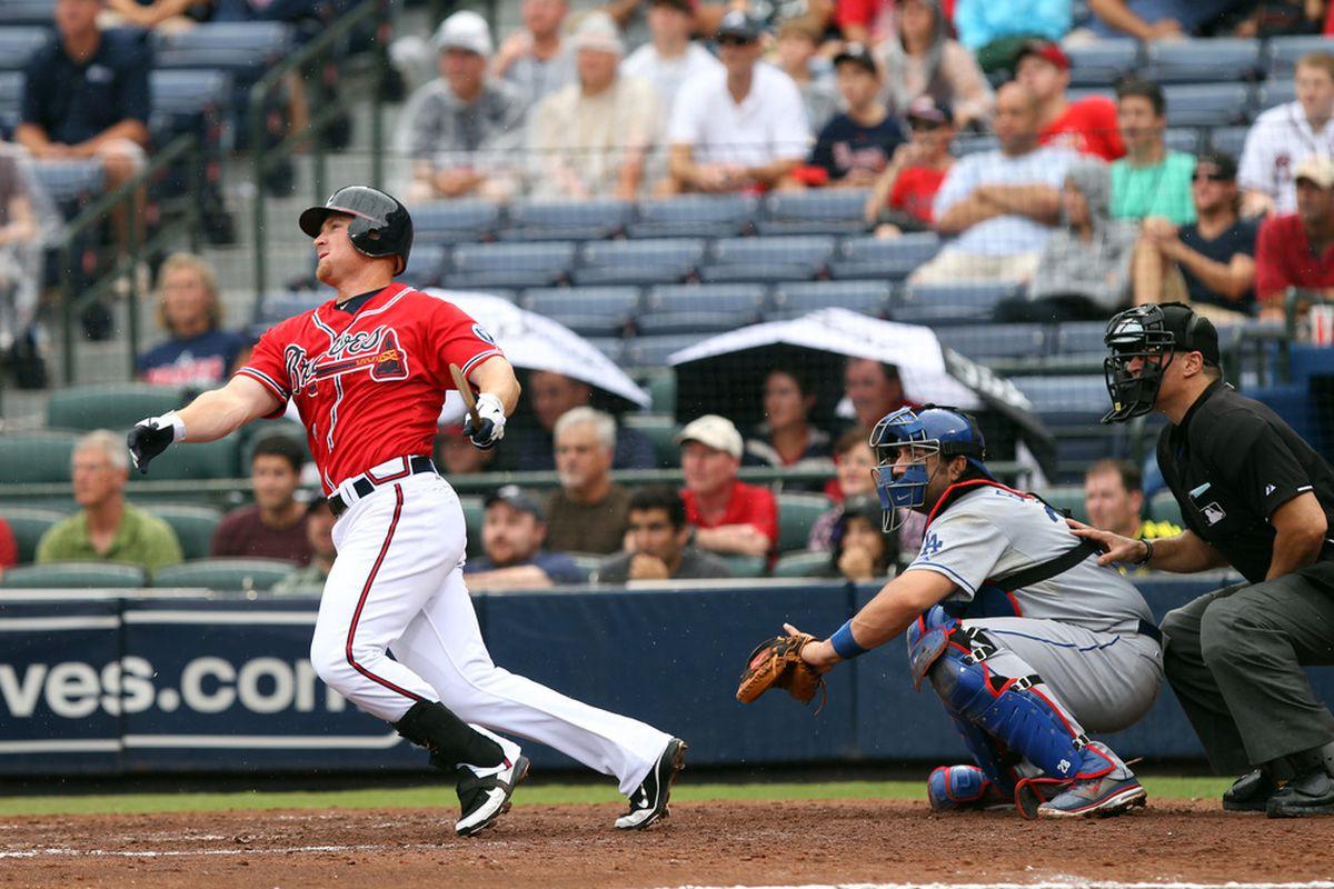 ATLANTA - SEPTEMBER 4: Brooks Conrad #7 of the Atlanta Braves hits a broken bat single for 2 RBI's against the Los Angeles Dodgers on September 4, 2011 at Turner Field in Atlanta, Georgia. (Photo by Joe Murphy/Getty Images)