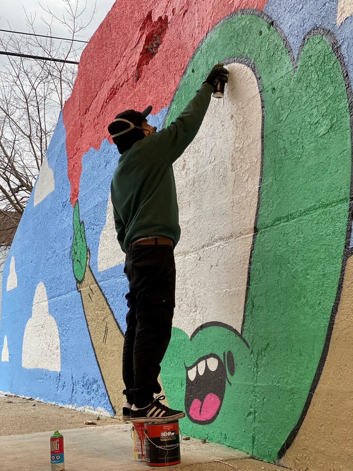 Muralist Manny Gomez's signature character is an alien — which he says is an artistic take on the way some people see Mexican people as illegal aliens.