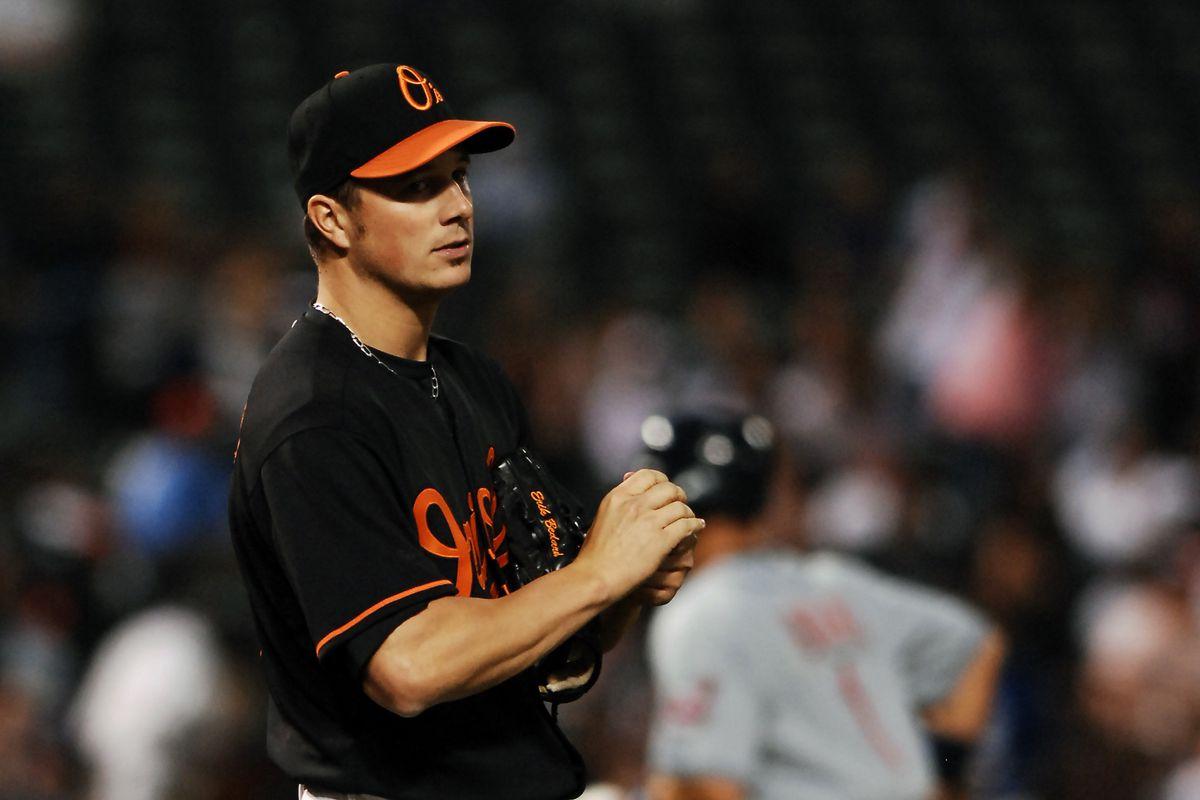 Baltimore Orioles starting pitcher Erik Bedard walks off the