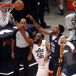 Utah Jazz White team forward Jahlil Tripp (56) puts in a shot ahead of Utah Jazz Blue team forward Shaqquan Aaron (60) as the Utah Jazz Blue and White teams play in summer league action at Vivint Smart Home Arena in Salt Lake City on Friday, Aug. 6, 2021. The White team won 83-65.