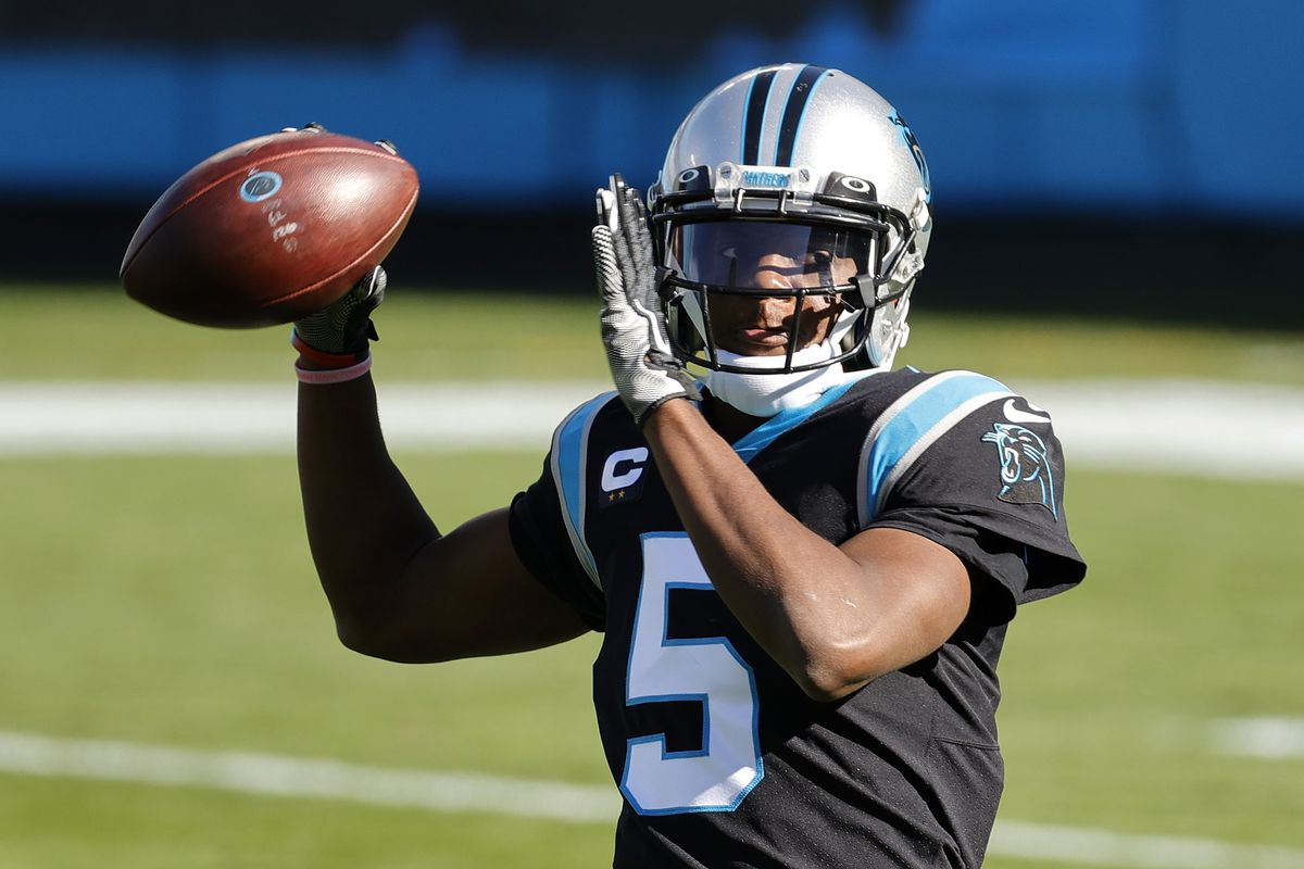 Teddy Bridgewater #5 of the Carolina Panthers tosses to stay loose during the first quarter of their game against the Denver Broncos at Bank of America Stadium on December 13, 2020 in Charlotte, North Carolina.