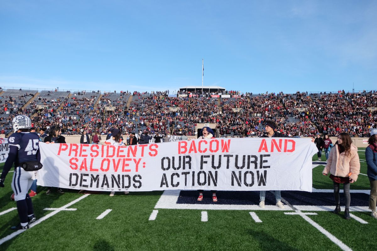 Protesters from Harvard and Yale interrupt the football game between their schools.
