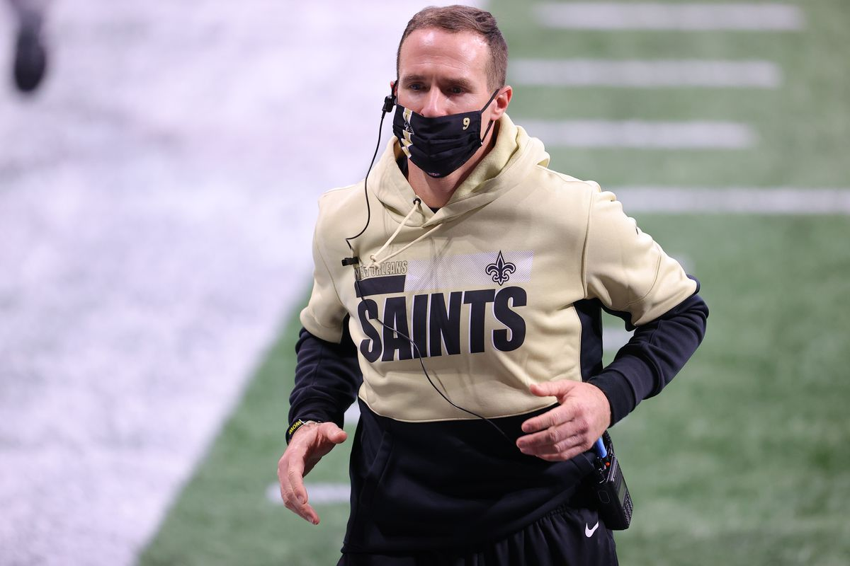 Drew Brees #9 of the New Orleans Saints leaves the field at halftime against the Atlanta Falcons in the second quarter against the New Orleans Saints at Mercedes-Benz Stadium on December 06, 2020 in Atlanta, Georgia.