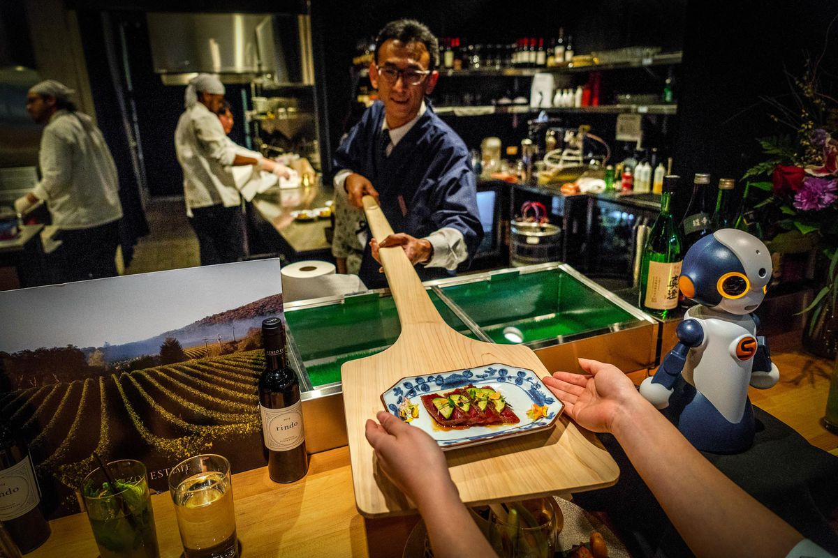 Diners seated at Junkichi's countertop may get dishes handed to them on a paddle from the chef.