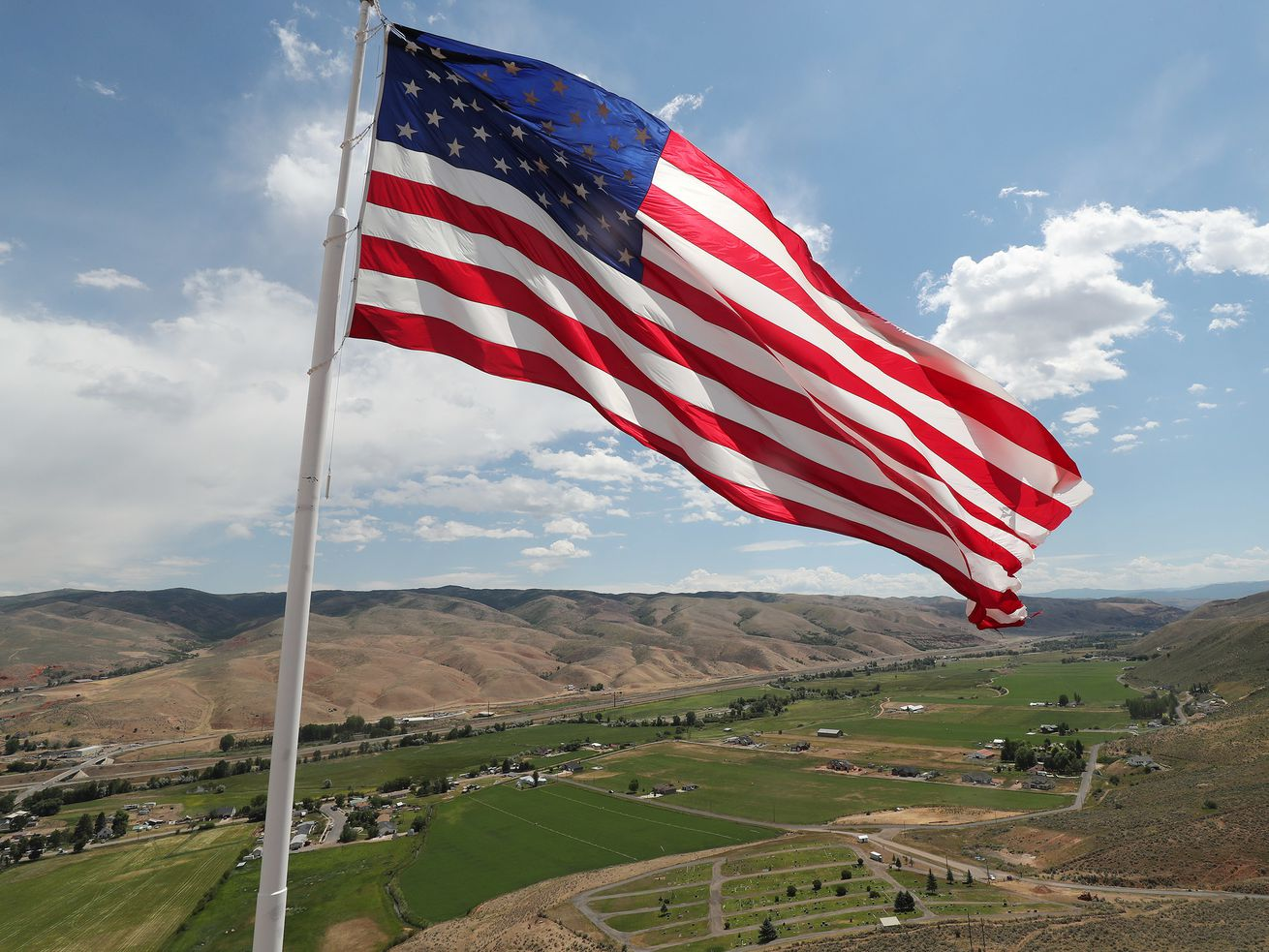 A 60-by-30-foot American flag flies over Henefer, Summit County, on July 3, 2018.