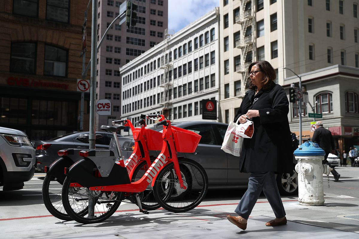 JUMP bikes sit parked on a street corner on April 12, 2018 in San Francisco, California.