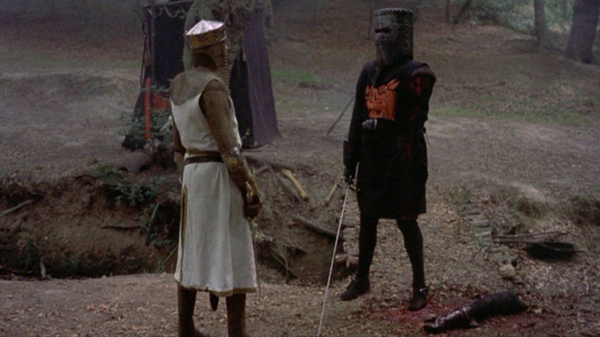 king arthur stands before a knight missing an arm