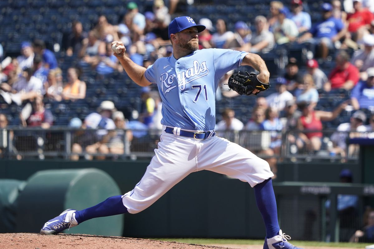 Wade Davis #71 of the Kansas City Royals throws in the seventh inning against the St. Louis Cardinals at Kauffman Stadium on August 15, 2021 in Kansas City, Missouri.
