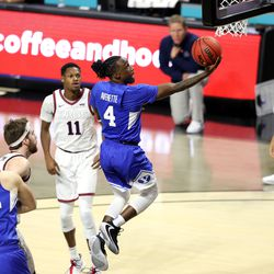 Brigham Young Cougars guard Brandon Averette (4) flies in for a layup as BYU and Gonzaga play in the finals of the West Coast Conference tournament at the Orleans Arena in Las Vegas on Tuesday, March 9, 2021.