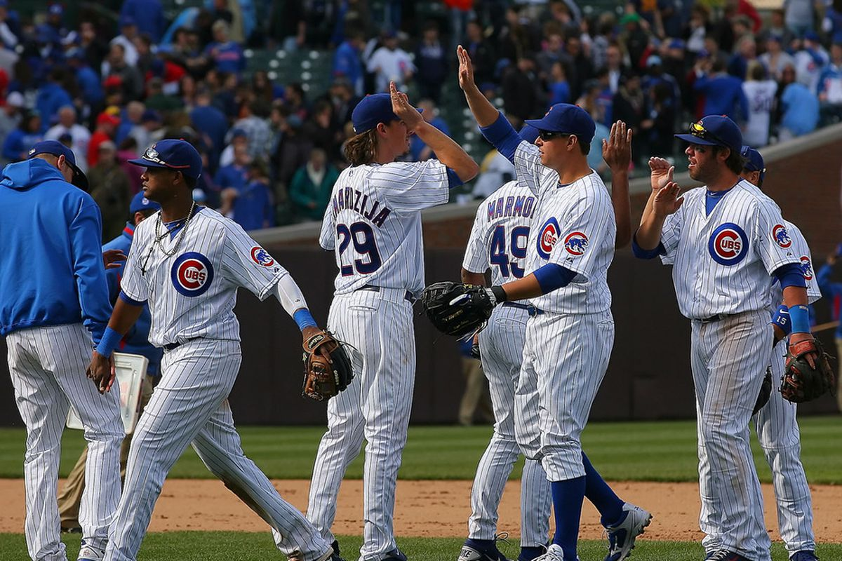 Chicago, IL, USA; The Chicago Cubs celebrate a victory over the Washington Nationals at Wrigley Field. The Cubs won 4-3. Mandatory Credit: Dennis Wierzbicki-US PRESSWIRE