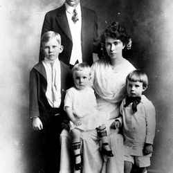 """This photo shows Richard Nixon's father, Francis """"Frank"""" Nixon,  and mother, Hannah Mulhous Nixon, and their children, left to right:  Harold, who died when he was 23, Donald and Richard, in Yorba Linda, California.  Date unknown.  (AP Photo)"""
