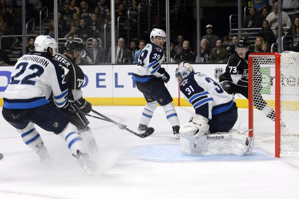 Kings #77 Jeff Carter scores on Jets #31 Ondrej Pavelec in second period action tonight