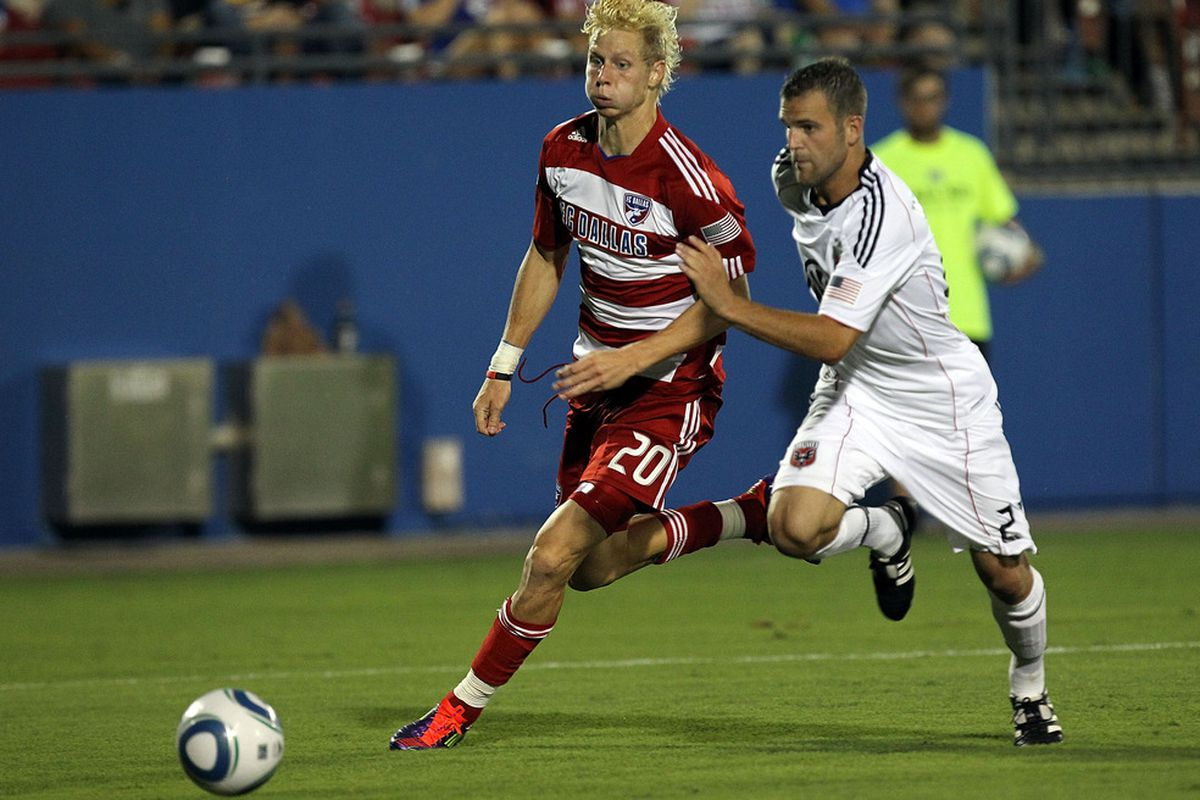 FRISCO, TX - JULY 16:  Brek Shea #20 of the FC Dallas dribbles the ball against Daniel Woolard #21 of the D.C. United at Pizza Hut Park on July 16, 2011 in Frisco, Texas.  (Photo by Ronald Martinez/Getty Images)