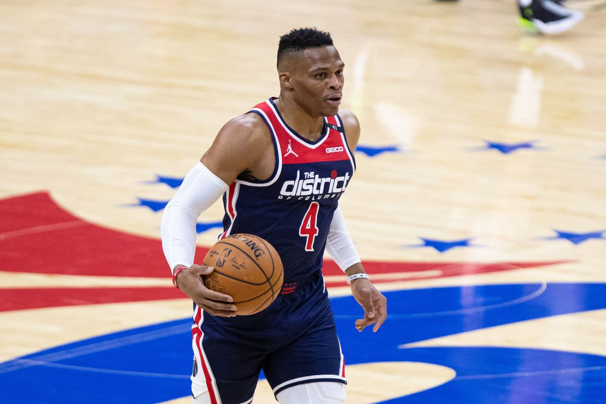 Washington Wizards guard Russell Westbrook dribbles up court against the Philadelphia 76ers during the first quarter at Wells Fargo Center.