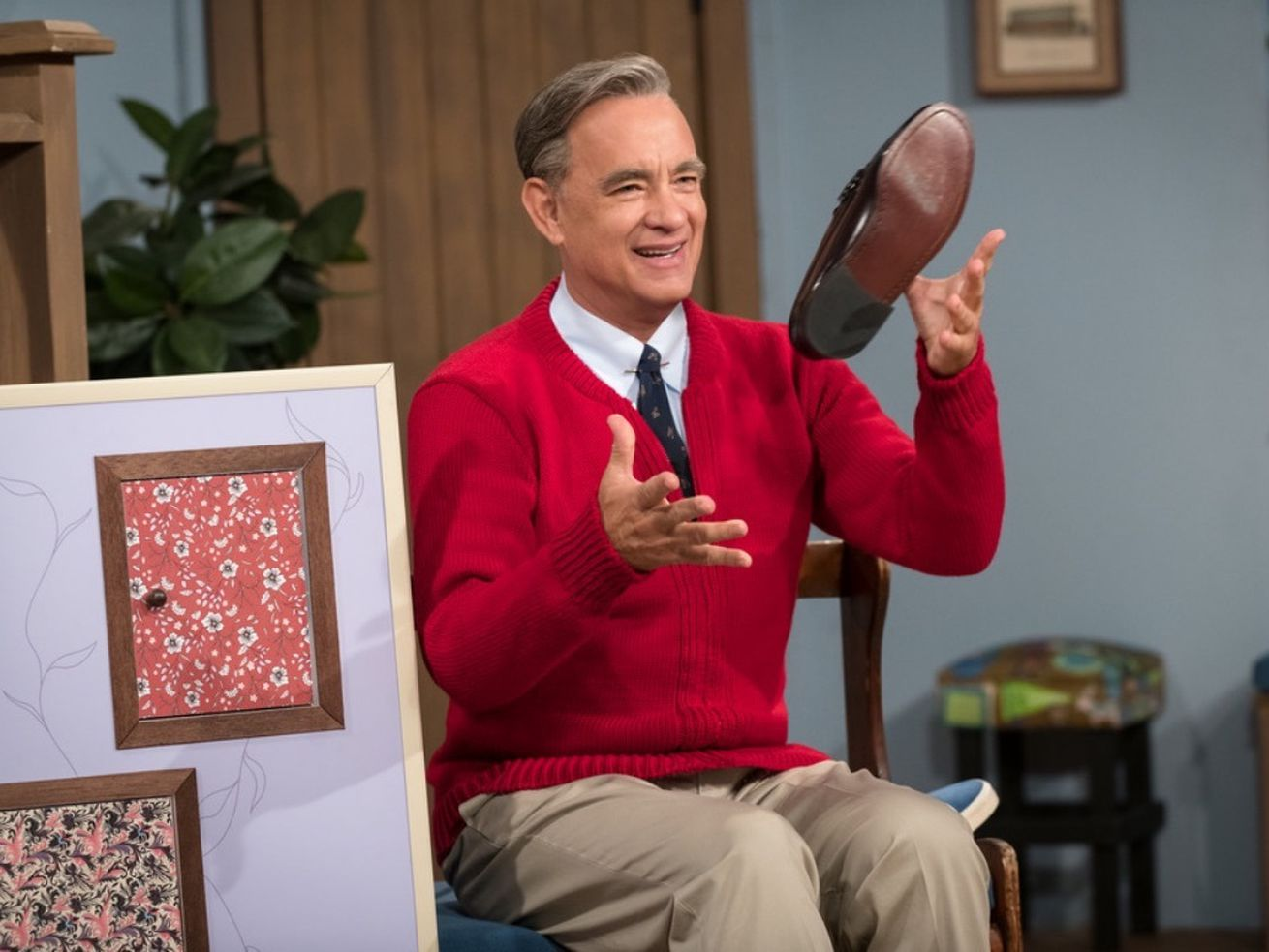 Tom Hanks tosses his shoe as Fred Rogers in A Beautiful Day in the Neighborhood, due out in November.