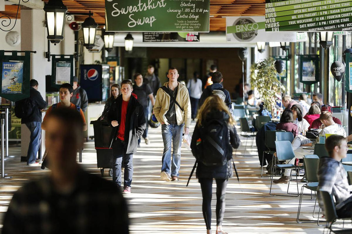 FILE - Utah Valley University students walk through the food court of the Sorensen Student Center on campus in Orem Wednesday, Jan. 21, 2015.