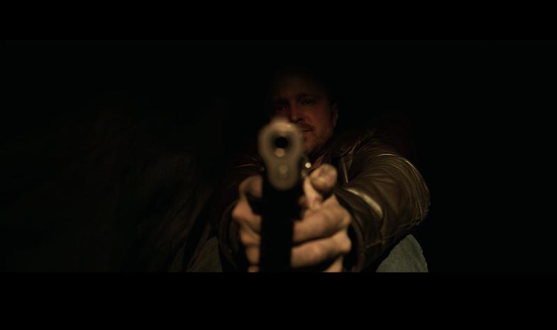 Jesse Pinkman hiding with his gun.