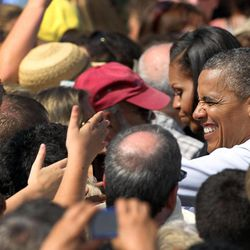 President Barack Obama greets supporters during a campaign stop , Friday, Sept. 7, 2012, in Portsmouth, N.H.