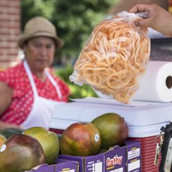 Zenaida Castillo, 60, serves chicharrones in Rogers Park.   Ashlee Rezin/Sun-Times
