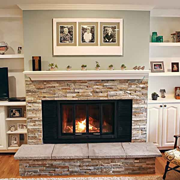 <p><strong>Shown:</strong> A new fireplace surround, hearth, and mantel lend the space a lighter, brighter look. Built-in shelves and base cabinets on either side provide both open and closed storage.</p>