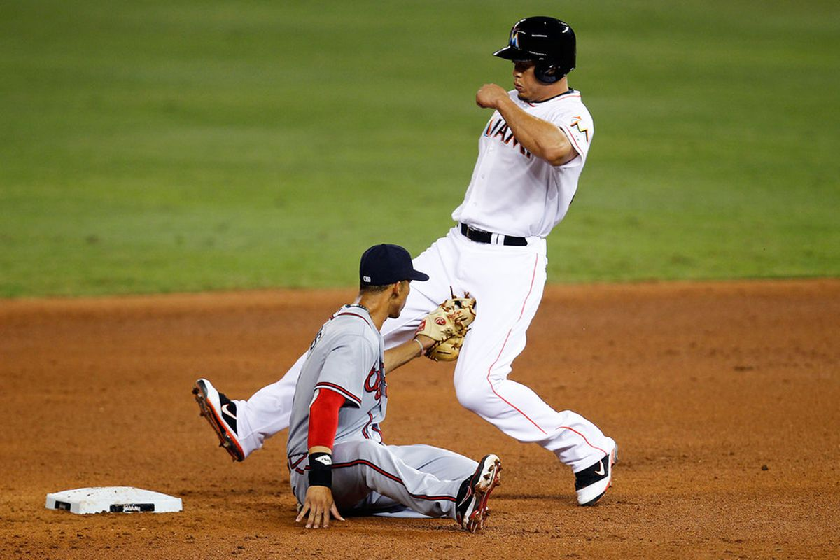 MIAMI, FL - JUNE 05:  Andrelton Simmons #19 of the Atlanta Braves tags out Giancarlo Stanton #27 of the Miami Marlins during a game at Marlins Park on June 5, 2012 in Miami, Florida.  (Photo by Sarah Glenn/Getty Images)