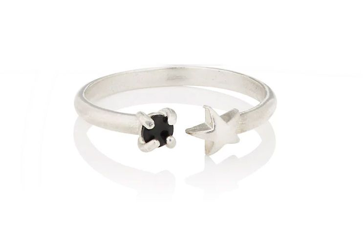A silver ring with a star and moon design